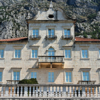 Tripković Palace in Dobrota, Montenegro<br /> Dobrota has several mansions that were built by rich maritime families and ship captains. The Tripković Palace is an example of just how beautiful and elaborate some of these palazzos were during the Republic of Venice era. The Tripković Family owned 18 ships and produced over 80 sailors; nearly 75% of them were captains of various fleets. The balustrade in the foreground is part of the second-story balcony with a stunning view of the bay. The palace has been fully restored but typically stands empty waiting for someone to rent its seven rooms, yacht and fifteen staff members.