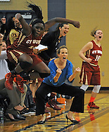 Cy-Woods' Olivia Ogwumike, left, and head coach Virginia Flores celebrate a Wildcats' field goal during the first half of a high school basketball game against Cy-Ranch, Tuesday, January 7, 2014, at Cypress Ranch High School in Cypress.