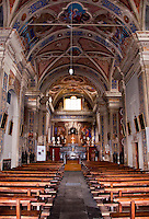 Ticino, Southern Switzerland. Interior of the church in Avegno.  Beautifully painted vaulted ceiling, square columns and ornate altar.