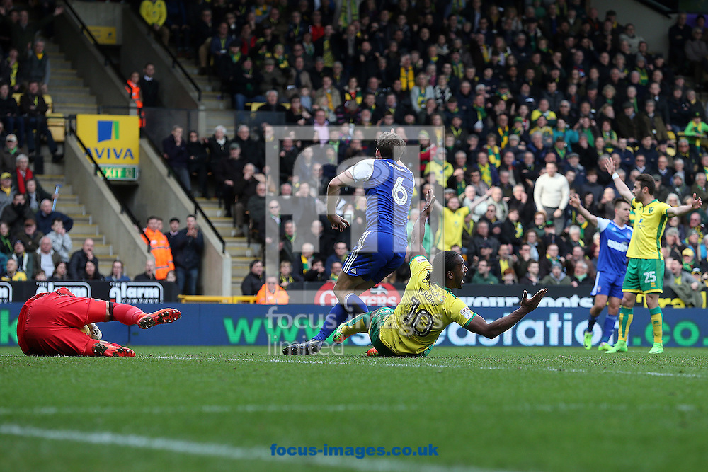 Cameron Jerome of Norwich is fouled by Christophe Berra of Ipswich Town but no penalty is awarded as offside had already been called during the Sky Bet Championship match at Carrow Road, Norwich<br /> Picture by Paul Chesterton/Focus Images Ltd +44 7904 640267<br /> 26/02/2017
