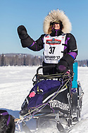 Musher Jessie Royer competing in the 45rd Iditarod Trail Sled Dog Race on the Chena River after leaving the restart in Fairbanks in Interior Alaska.  Afternoon. Winter.