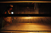 Silk factory loom and weaver. Suzhou, China.