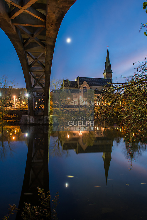 St. Georges Church, as seen from underneath the Heffernan street footbridge over the speed river, at night.  Photo by Andrew Goodwin