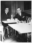 Igor Stravinsky (right), 1882-1971, Russian composer, pianist and conductor and Boris Kochno, 1904-90, Russian poet, dancer and librettist, sitting in a cafe, photograph. Copyright © Collection Particuliere Tropmi / Manuel Cohen