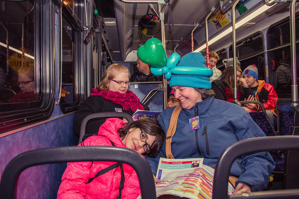 Guests enjoying the free METRO shuttle at First Night Akron 2015