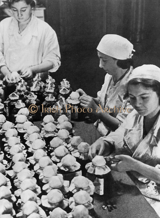Sealing and labelling some of the thousands of flasks of blood donated by citizens of Moscow: 1941.  World War II