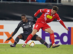 LIVERPOOL, ENGLAND - Thursday, December 10, 2015: Liverpool's Divock Origi in action against FC Sion's Veroljub Salatic during the UEFA Europa League Group Stage Group B match at Stade de Tourbillon. (Pic by David Rawcliffe/Propaganda)