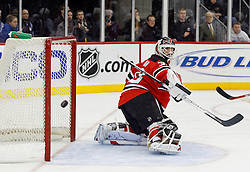 February 13, 2008; Newark, NJ, USA;  New Jersey Devils goalie Martin Brodeur (30) watches a shot go wide during the third period at the Prudential Center in Newark, NJ. The New Jersey Devils beat the Ottawa Senators 3-2 on an overtime goal by New Jersey Devils right wing Brian Gionta (14).