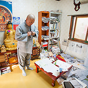 A monk in his office at a small temple in Busan, South Korea.