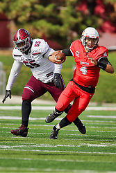 NORMAL, IL - October 13: Brady Davis exploits a hole in the middle to escape the clutches of Tyree Jackson during a college football game between the ISU (Illinois State University) Redbirds and the Southern Illinois Salukis on October 13 2018 at Hancock Stadium in Normal, IL. (Photo by Alan Look)