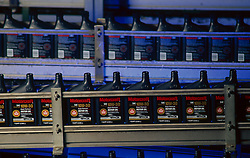 Stock photo of bottles of motor oil passing by on a production line