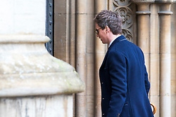 © Licensed to London News Pictures. 31/03/2018. Cambridge, UK. Eddie Redmayne arrives at the funeral of Stephen Hawking at Church of St Mary the Great in Cambridge, Cambridgeshire. Professor Hawking, who was famous for ground-breaking work on singularities and black hole mechanics, suffered from motor neurone disease from the age of 21. He died at his Cambridge home in the morning of 14 March 2018, at the age of 76. Photo credit: Rob Pinney/LNP