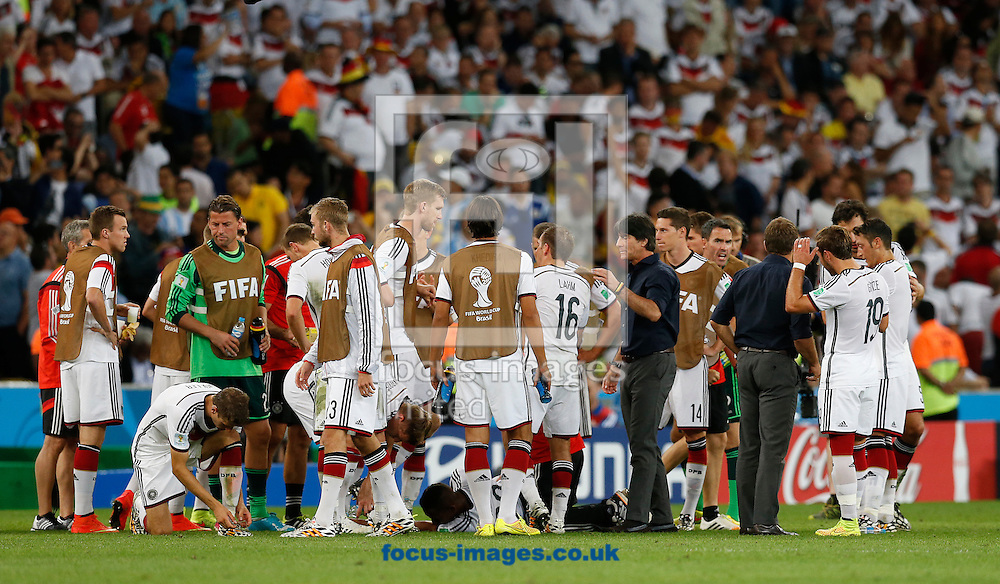 Germany's head coach Joachim Low talks to his players at the end of normal time during the 2014 FIFA World Cup Final match at Maracana Stadium, Rio de Janeiro<br /> Picture by Andrew Tobin/Focus Images Ltd +44 7710 761829<br /> 13/07/2014