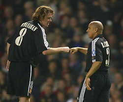 MANCHESTER, ENGLAND - Wednesday, April 23, 2003: Real Madrid's Roberto Carlos (r) celebrates a 6-5 aggregate victory over Manchester United in the UEFA Champions League Quarter Final 2nd Leg match at Old Trafford. (Pic by David Rawcliffe/Propaganda)