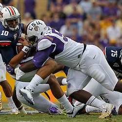 October 22, 2011; Baton Rouge, LA, USA; LSU Tigers defensive tackle Anthony Johnson (56) sacks Auburn Tigers quarterback Kiehl Frazier (10) during the second half at Tiger Stadium. LSU defeated Auburn 45-10. Mandatory Credit: Derick E. Hingle-US PRESSWIRE / © Derick E. Hingle 2011