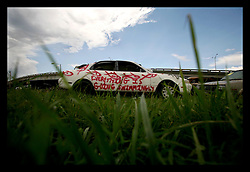 04 July 2006 - New Orleans - Louisiana. Graffiti on wrecked cars. Everything is going swimmingly. Independence Day and the graffiti on abandoned, flooded cars says it all. New Orleans celebrates July 4th.