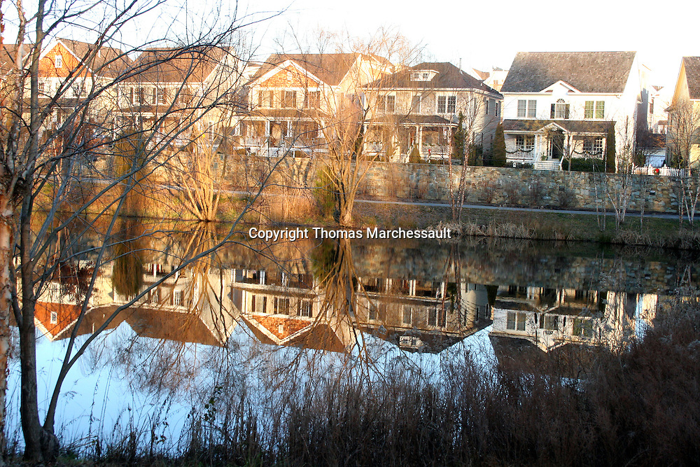 Reflection of Booth Street houses in Lake Veruna, Kentlands, Gaithersburg, Maryland