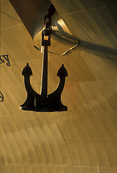 Anchor hanging from the side of a large tanker