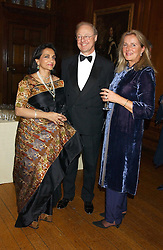 Left to right, NAZLI JAFFERJEE and NICK & ANNIE CHANCE he is Prince Michael of Kent's Private Secretary at a fundraising dinner in aid of the Hoedspruit Endangered Species Foundation in the presence of TRH Rrince & Princess Michael of Kent at Kensington Palace, London on 2nd March 2006.<br />