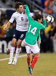 United States forward Clint Dempsey (8) leaps over Mexico midfielder Israel Martinez (14).  The United States men's soccer team defeated the Mexican national team 2-0 in CONCACAF final group qualifying for the 2010 World Cup at Columbus Crew Stadium in Columbus, Ohio on February 11, 2009.