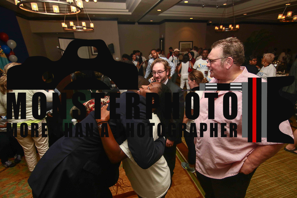 Democratic primary candidate for mayor Eugene Young (Left) hugs a volunteers after losing the Wilmington Mayor's race to Mike Purzycki, Tuesday, September. 13, 2016, at the Sheraton Hotel in Wilmington.
