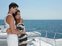 Young couple embracing on yacht