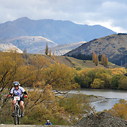 Jacqui Hyde (front) and Kenneth Mitchell (left) in action during the New World Tour de Wakatipu bike race on Saturday. Six hundred and ninety people entered the bike race which featured an  exclusive course with breathtaking views from Millbrook Resort in Arrowtown to Chard Farm along the Kawarau River, via the trails and tracks of the Wakatipu basin with distances of 36 kilometres fun riding for recreational bikers and 45 kilometres for elite and sport racers. The event was part of the inaugural Queenstown Bike Festival, which took place from 16th-25th April. The event hopes to highlight Queenstown's growing profile as one of the three leading biking centres in the world. Queenstown, Central Otago, New Zealand. 23rd April 2011. Photo Tim Clayton..