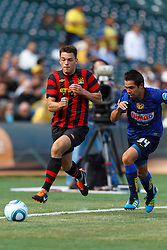 July 16, 2011; San Francisco, CA, USA;  Manchester City defender Frederic Veseli (56) dribbles past Club America defender George Corral (34) during the first half at AT&T Park. Manchester City defeated Club America 2-0.