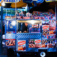 Street Vendor Selling Hot Dogs on Times Square at Night. Manhattan, New York City