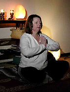 Instructor Sandy Wright, from Beavercreek during a yoga class at The Studio, in Beavercreek, Thursday, March 22nd.
