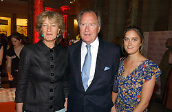 Left to right, MR & MRS PIERS VON WESTENHOLZ and their daughter VIOLET VON WESTENHOLZ at a party at the V&A museum, Cromwell Road, London for three exhibitions - Sixties Fashion, Sixties Graphics and Che Guevara:Revolutionary and icon held on 5th June 2006.<br /><br />NON EXCLUSIVE - WORLD RIGHTS