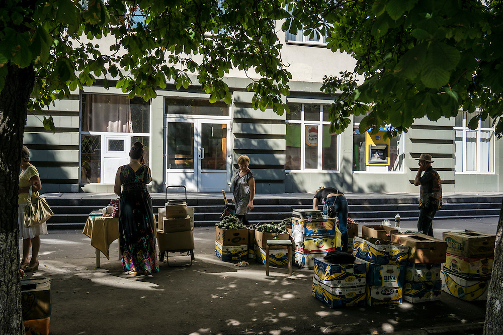 MARIUPOL, UKRAINE - AUGUST 30, 2015: Produce for sale on the street in Mariupol, Ukraine. Despite the front line being a relatively short distance away, Mariupol was lively on a warm summer weekend, with little evidence that people expect the fighting to advance this far. CREDIT: Brendan Hoffman for The New York Times