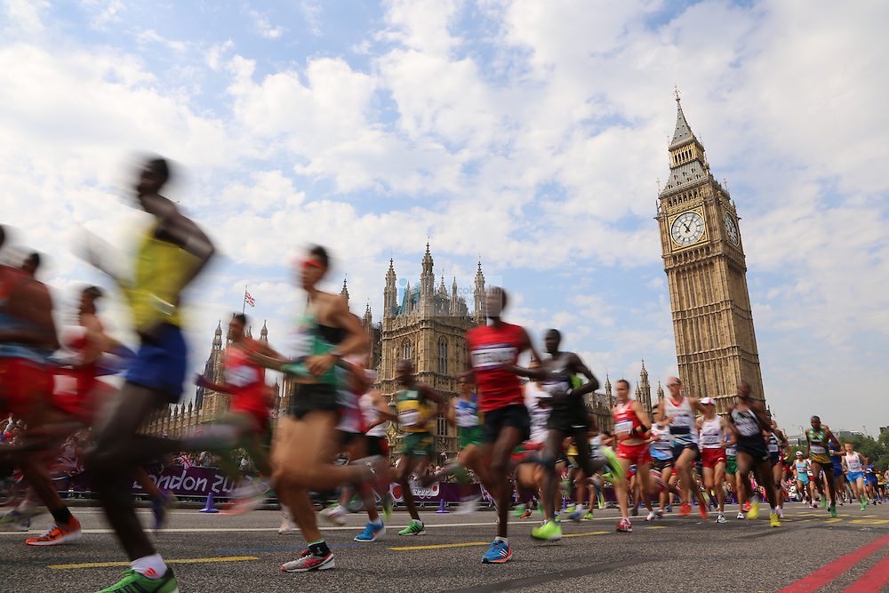 Runners pass by BIg Ben during the men's marathon during day 16 of the London Olympic Games in London, England, United Kingdom on August 12, 2012..(Jed Jacobsohn/for The New York Times)...
