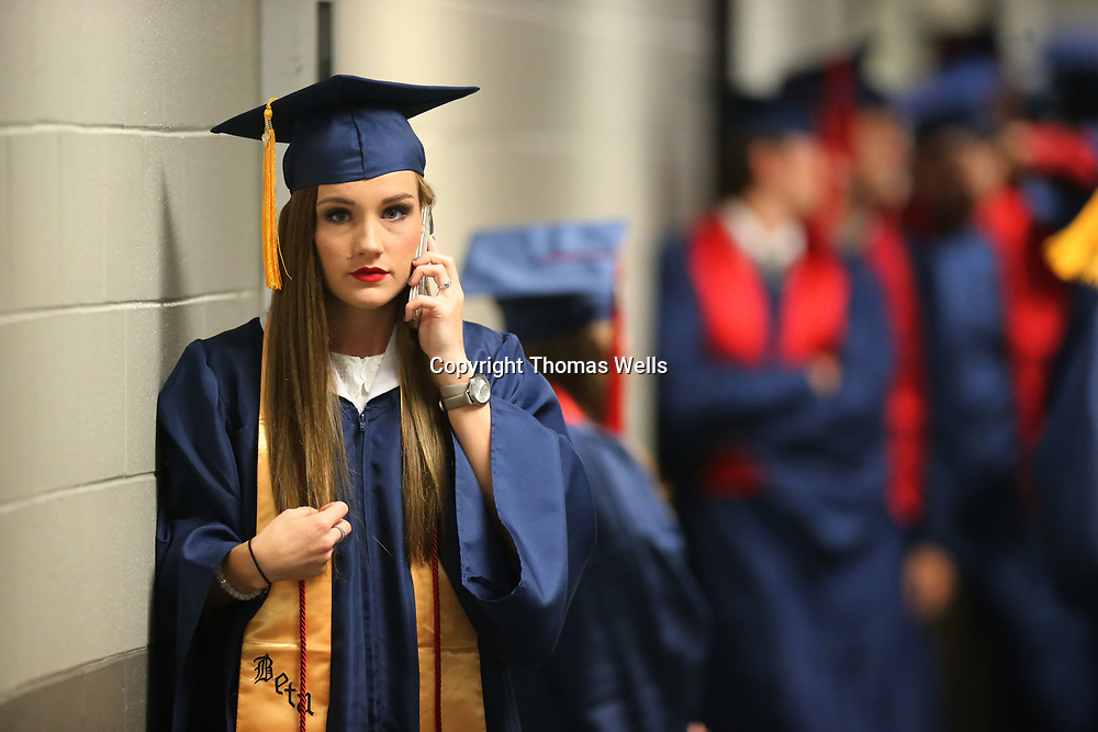Nattleton's Katelyn Lowery tries to call her mom and give her directions how to get backstage before their graduation on Saturday.