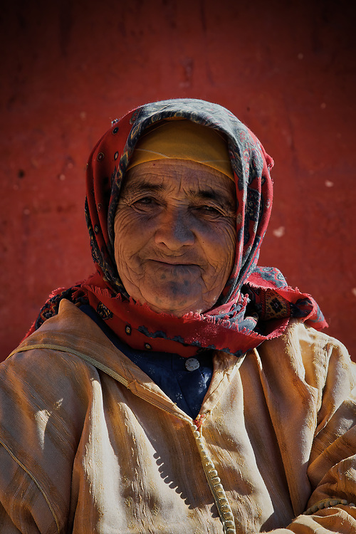 The Moroccan Mona Lisa - I met this lady at the end of a trek on christmas day! <br /> She was sitting squinting into the sun at the end of a path... she loved having <br /> her photo taken! she even gave me a satsuma! - just like christmas after all!