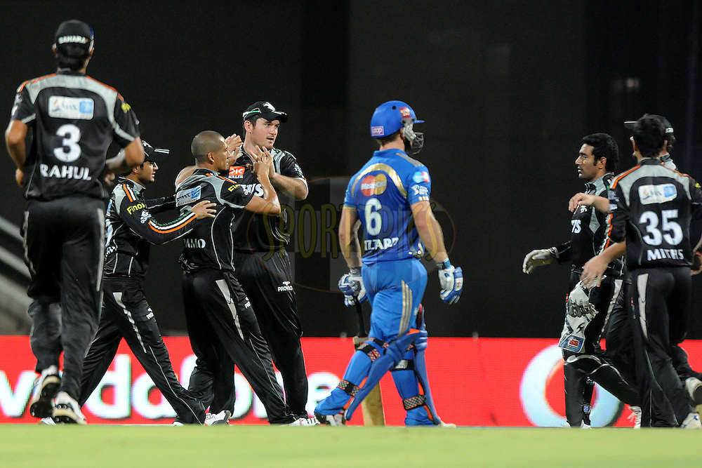 Pune Warriors India celebrate a wicket during  match 44 of the Indian Premier League ( IPL ) Season 4 between the Pune Warriors India and the Mumbai Indians held at the Dr DY Patil Sports Academy, Mumbai India on 4th May 2011...Photo by Pal Pillai/BCCI/SPORTZPICS.