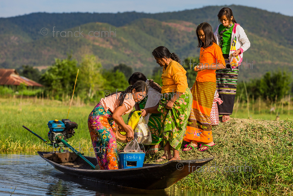 INLE LAKE, MYANMAR - DECEMBER 09, 2016 : local people traveling by boat on the Inle Lake Shan state in Myanmar (Burma)