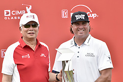 October 15, 2017 - Kuala Lumpur, MALAYSIA - Pat Perez of USA pictured with Malaysia's Prime Minister Najib Razak after he won the CIMB Classic 2017 on October 15, 2017 at TPC Kuala Lumpur, Malaysia. (Credit Image: © Chris Jung via ZUMA Wire)