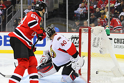 Dec 18, 2013; Newark, NJ, USA;  New Jersey Devils right wing Jaromir Jagr (68) scores a goal on Ottawa Senators goalie Robin Lehner (40) during the second period at the Prudential Center.