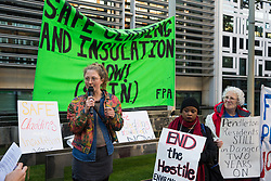 London, UK. 17 October, 2019. Indigo of Extinction Rebellion addresses campaigners from Fuel Poverty Action (FPA), residents in uninsulated homes and climate activists protesting outside the Ministry of Housing, Communities and Local Government (MHCLG) before delivering a letter signed by FPA, 80 organisations, trade unions and MPs in just ten days precisely one year after a strongly worded letter about the urgency of recladding flammable buildings and insulating those that are cold was delivered to the Government department. Commitments made by the MHCLG in response to the original letter have not been met. Credit: Mark Kerrison/Alamy Live News