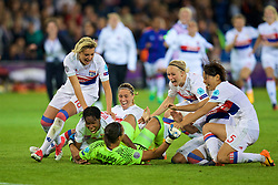 CARDIFF, WALES - Thursday, June 1, 2017: Olympique Lyonnais players celebrates with goalkeeper Sarah Bouhaddi after winning the cup following a 7-6 penalty shoot-out victory over Paris Saint-Germain during the UEFA Women's Champions League Final between Olympique Lyonnais and Paris Saint-Germain FC at the Cardiff City Stadium. (Pic by David Rawcliffe/Propaganda)