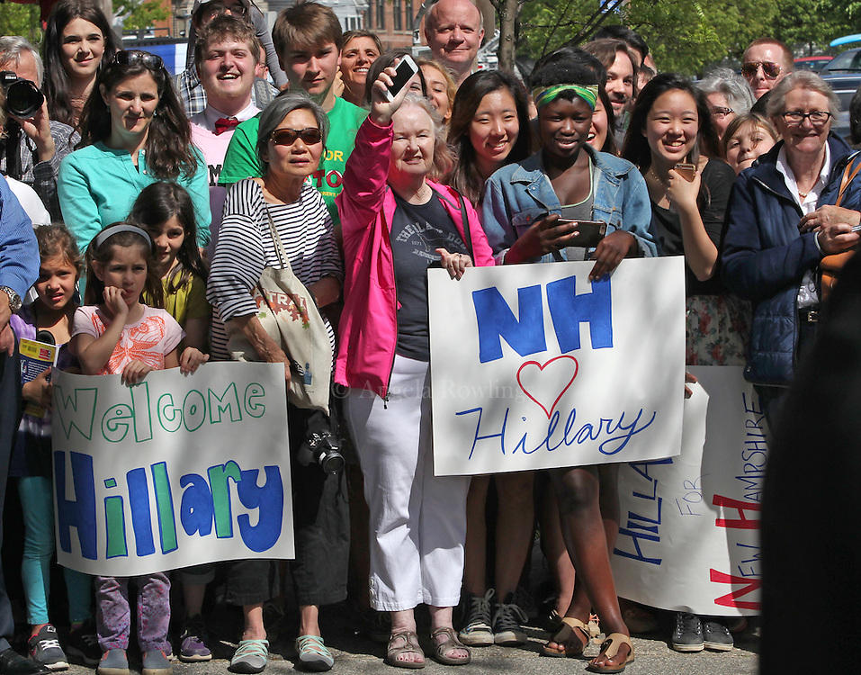 (Exeter, NH - 5/22/15) A crowd waits for a glimpse of former Secretary of State and presidential candidate Hillary Clinton as she makes a campaign stop on Water Street in Exeter, Friday, May 22, 2015. Staff photo by Angela Rowlings.