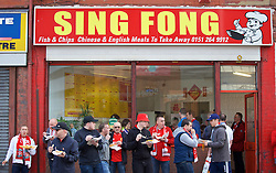 LIVERPOOL, ENGLAND - Thursday, May 5, 2016: Liverpool supporters eat chips from the Sing Fong before the UEFA Europa League Semi-Final 2nd Leg match against Villarreal CF at Anfield. (Pic by David Rawcliffe/Propaganda)