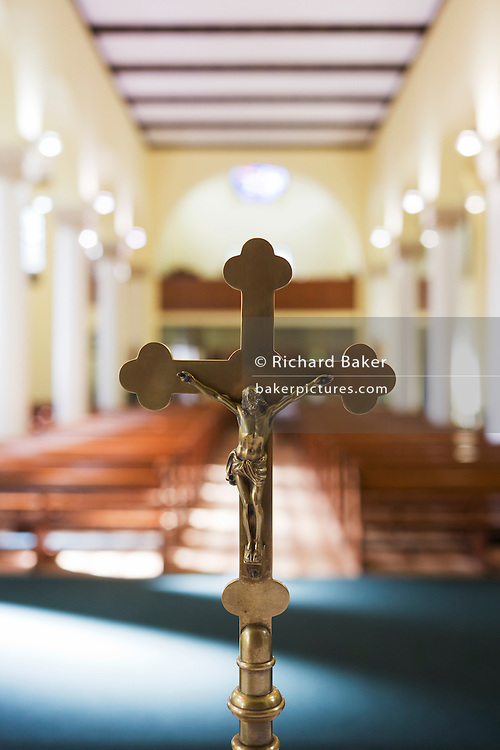 Crucifix on altar at St. Lawrence's Catholic church in Feltham, London.
