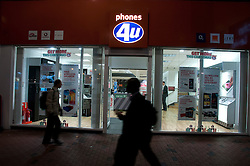 Shoppers pass a Phones 4u shop, Reading, Berkshire, England, 13 November 2013. Picture by Jonathan Mitchell / i-Images