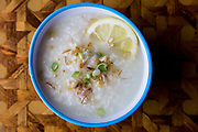 A Filipino dish called Lugaw, is made with rice, water, ginger, chopped chicken breast, lemon, dried garlic, green onions and chicken base powder at Uncle Mike's Place on Tuesday, May 31, 2016.