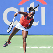 COCO GAUFF hits a serve at the Rock Creek Tennis Center.