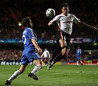 Photo: Paul Thomas.<br /> Chelsea v Valencia. UEFA Champions League. Quarter Final, 1st Leg. 04/04/2007.<br /> <br /> Andriy Shevchenko (Blue) of Chelsea and Asier Del Horno battle for the ball.