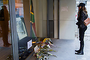 Brussels Belgium 6th December 2013. At the South African Embassy in Brussels people gather, Nelson Mandela died just yesterday.a woman takes a moment of silence at the tribute