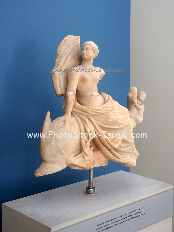 Classic statue of a woman on a dolphin, at the Archaeological Museum of Samothrace, Samothrace Island, Greece